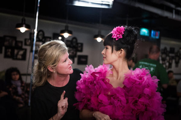 "Director Dennie Gordon talks with Ziyi Zhang on the set of the movie ""My Lucky Star."""