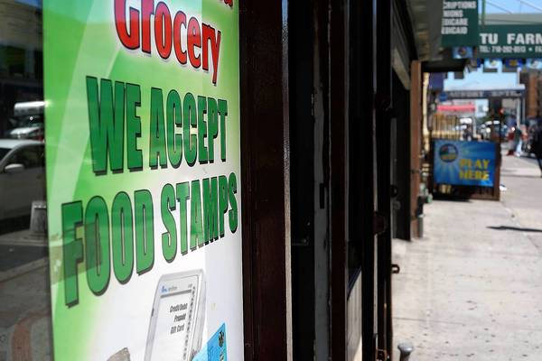 The GOP-controlled House voted this week to pass budget cuts that would kick nearly 4 million people off the food stamps program. Above, a store in New York advertises that it accepts food stamps.