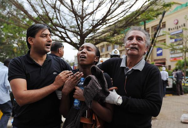 A woman who had been held hostage was freed after a security operation at an upscale shopping mall in Nairobi. At least 11 people were killed, with some reports putting the number higher than 22.