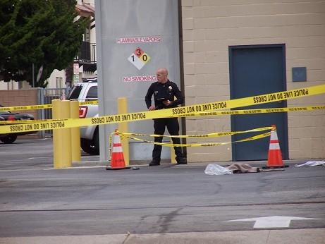 An officer stands outside the Culver City Police Department in 2003. On Saturday, police shot a person who jumped over a fence at the station.