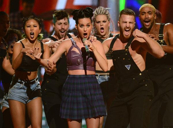 Katy Perry, center, performs during the iHeartRadio Music Festival at the MGM Grand Garden Arena in Las Vegas.