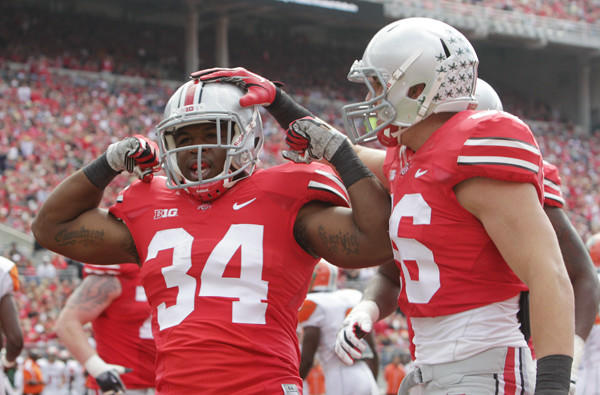 Ohio State running back Carlos Hyde (34) celebrates his touchdown against Florida A&M with teammate Jeff Heuerman in the first quarter Saturday.