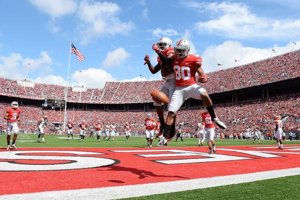 Chris Fields (80) of the Ohio State Buckeyes celebrates his 16-yard touchdown catch in the second quarter against the Florida A&M Rattlers with teammate Dontre Wilson.