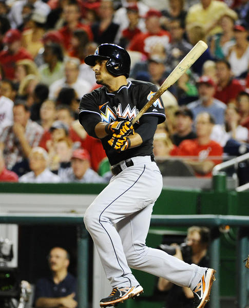 Sep 20, 2013; Washington, DC, USA; Miami Marlins second baseman Donovan Solano (17) hits a single during the sixth inning against the Washington Nationals at Nationals Park.