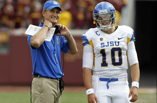 San Jose State Coach Ron Caragher and quarterback David Fales watch as a play is reviewed during the first quarter of their game at Minnesota on Saturday.
