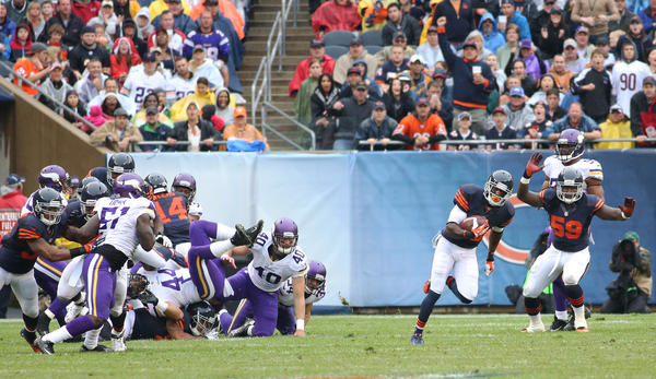 Devin Hester breaks away from the pack on his way to an 80-yard kickoff return in the second quarter against the Vikings at Soldier Field.