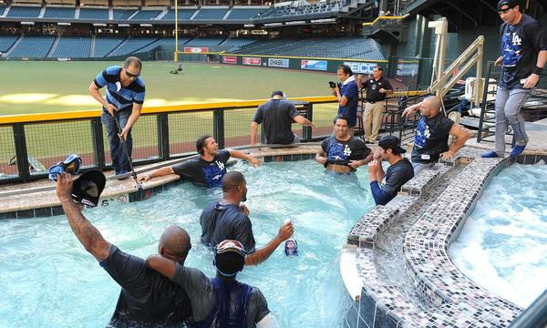 The Dodgers celebrate in the Arizona Diamondbacks' pool after winning the NL West Division title on Thursday.