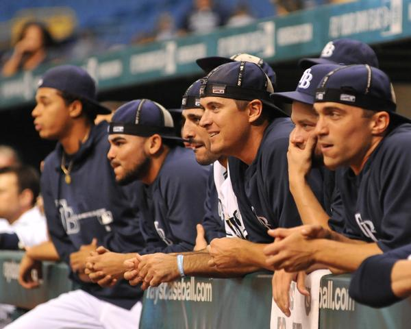 Rays players turn their caps inside out as Friday's game enters the 17th inning against the Orioles.