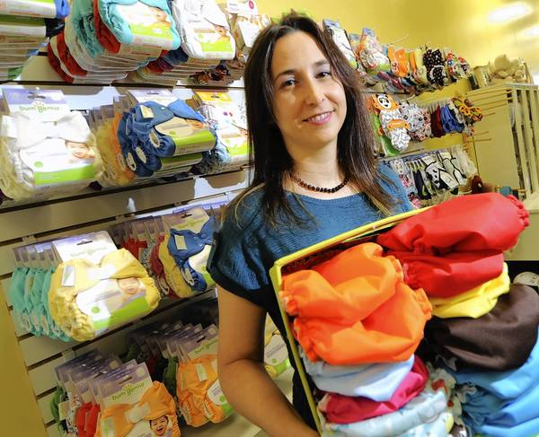 Ju-Ju Monkey owner Sara Moore holds AppleCheeks reusable cloth diapers in her store. Ju-Ju Monkey, a natural parenting store selling environmentally-friendly and sustainable products for children and parents, is set to open next week at 4755 W. Tilghman St. in South Whitehall Township.