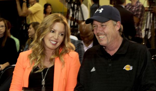"In her updated memoir, ""Laker Girl,"" Lakers executive Jeanie Buss says she was 'devastated' after her brother, Jim Buss, right, decided he wouldn't hire Phil Jackson to replace the fired Mike Brown as coach."