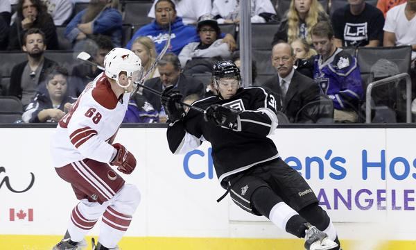 Kings forward Valentine Zykov, right, attempts to control the puck in front of Phoenix Coyotes defenseman James Melindy during a preseason game on Sunday.