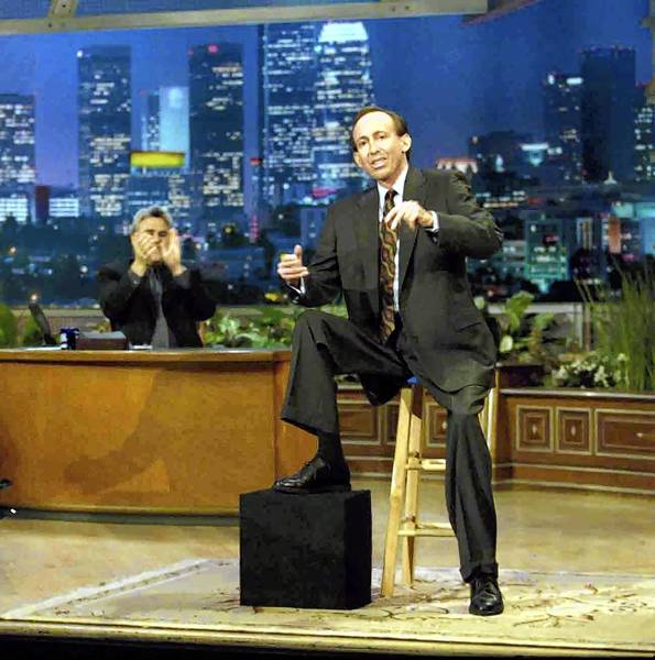 "Comedian Brett Leake performs on ""The Tonight Show"" in 1999. Leake, who has muscular dystrophy, rested on a stool at that stage of his career."