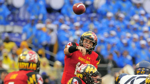 Maryland quarterback C.J. Brown passes over his offensive line for a completion to wide receiver Deon Long.