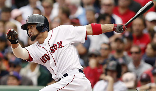 Boston's Shane Victorino hits an RBI single against the New York Yankees at Fenway Park on Sept. 14.