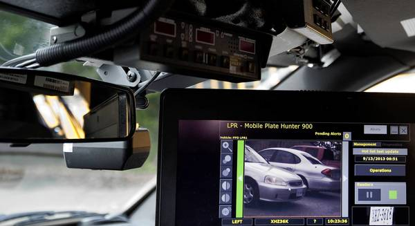 Poquoson Police demonstrate the use of a license plate reader on Sept. 13. The department received the reader a year ago from a Department of Homeland Security grant, and it is still in a testing phase.