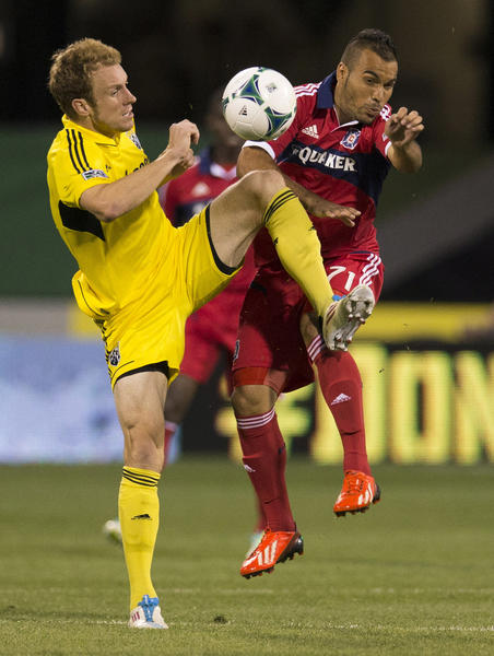 Crew defender Tyson Wahl and Fire midfielder Alex battle for the ball at Crew Stadium.