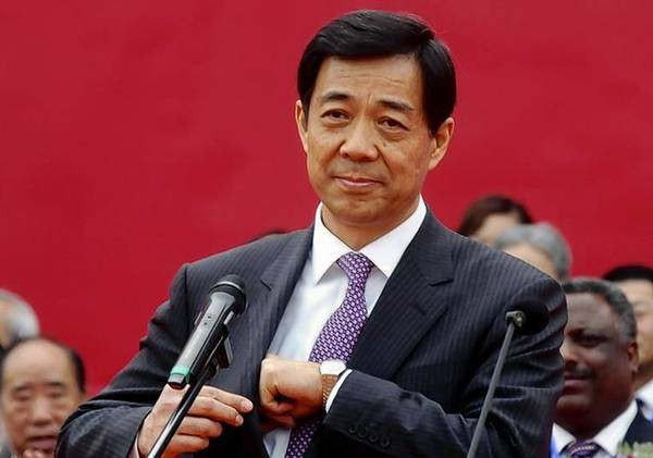 Bo, then China's Minister of Commerce, attends the opening ceremony of a China International SME fair in Zhengzhou.