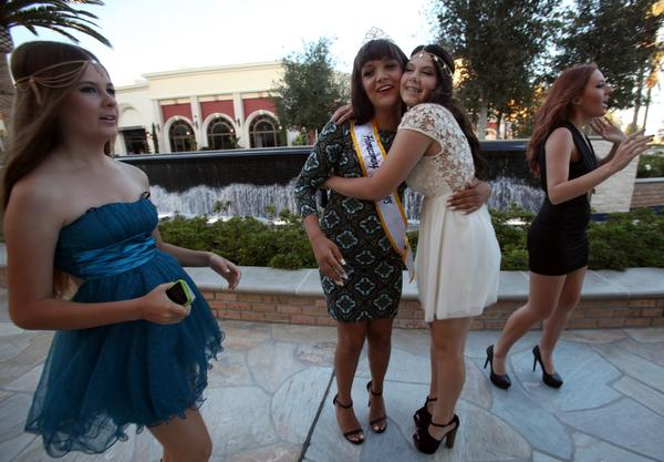 Friends, from left, Jasmine Poli, 14, Cassidy Lynn Campbell, 16, Melissa Hooper, 17, and Bobbie Wilkinson, 17, get together to have their photos taken in Huntington Beach before the homecoming dance.