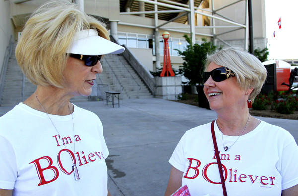 Sister Karen Shelton, left, and Sue Schrader, longtime Cornhuskers fans from Lincoln, Neb., wear shirts in support of football Coach Bo Pelini on Saturday.