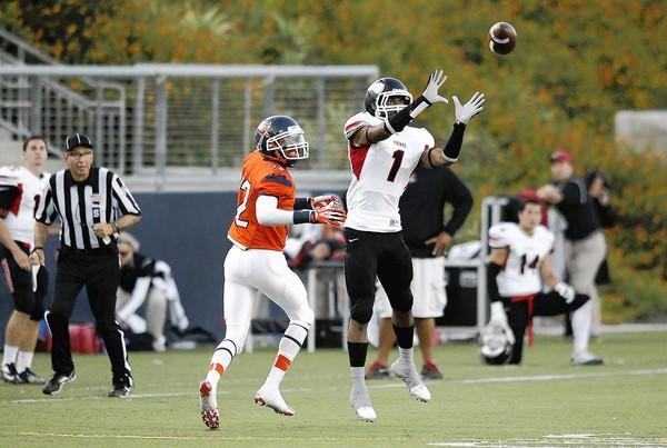 Long Beach City College's Kameron White intercepts a ball intended for Orange Coast College's D.J. McFadden.