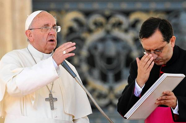 "Pope Franics blesses the crowd at St. Peter's Square this week. In an interview, the pontiff said of homosexuality, abortion and contraception, ""It is not necessary to talk about these issues all the time."""