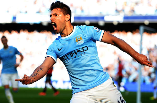 Manchester City forward Sergio Aguero celebrates as he scores the first goal of the game against Manchester United on Sunday in an English Premier League game at Etihad Stadium.