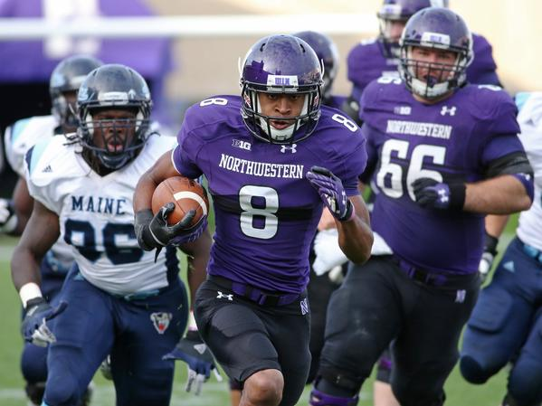 Northwestern's Stephen Buckley (8) rushes in the fourth quarter against Maine at Ryan Field in Evanston,