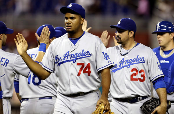 Dodgers closer Kenley Jansen, center, celebrates with teammates after a victory over the Miami Marlins last month.