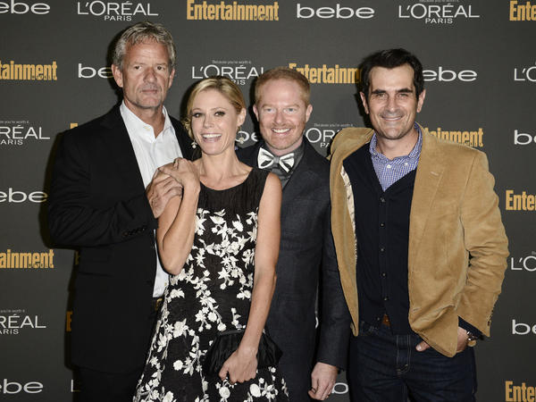 "From left, ""Modern Family"" co-creator Christopher Lloyd and stars Julie Bowen, Jesse Tyler Ferguson and Ty Burrell arrive at Entertainment Weekly's pre-Emmy party."