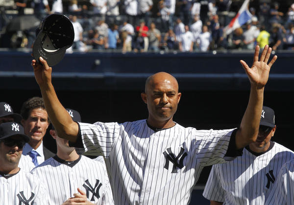 Yankees relief pitcher Mariano Rivera waves to fans during a pregame ceremony honoring him before the game against the San Francisco Giants at Yankee Stadium.