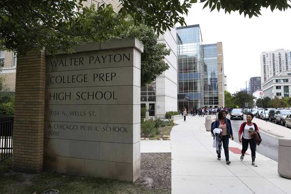 Students leave Walter Payton College High Prep School after classes Wednesday, the day Mayor Rahm Emanuel announced the school's $17 million expansion.