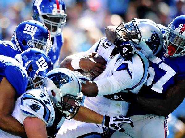 Cam Newton (center) of the Carolina Panthers scores a touchdown against the New York Giants at Bank of America Stadium.