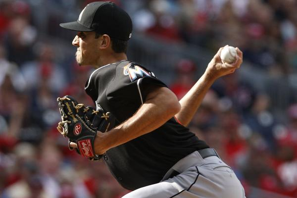 WASHINGTON, DC - SEPTEMBER 22: Steve Cishek #31 of the Miami Marlins earns a save as he pitches against the Washington Nationals in the ninth inning of game 1 of their day-night doubleheader at Nationals Park on September 22, 2013 in Washington, DC. The Marlins won the game, 4-2.