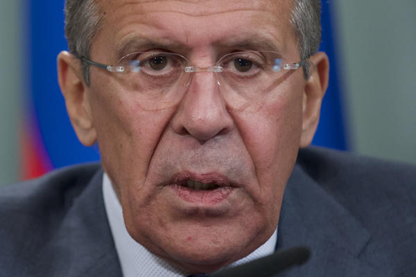 Russian Foreign Minister Sergei Lavrov holds a news conference after his meeting with French counterpart Laurent Fabius in Moscow.