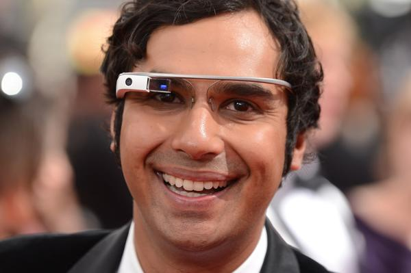 Kunal Nayyar, wearing Google Glass, arrives Sunday at the 65th Primetime Emmy Awards at Nokia Theatre in Los Angeles.