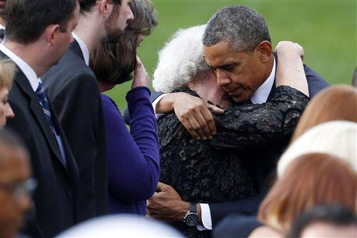 President Obama comforts a woman at a memorial service for the victims of the Washington Navy Yard shooting.