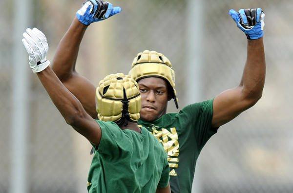 Long Beach Poly receiver John Smith celebrates with a teamate after catching a touchdown pass against Serra during the Edison passing tournamnet last summer.