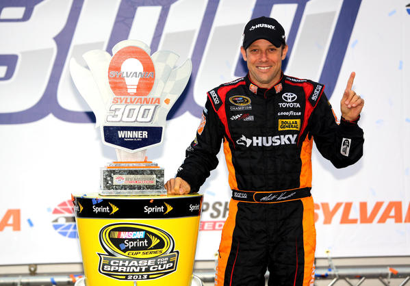 Matt Kenseth, driver of the #20 Home Depot / Husky Toyota, celebrates in Victory Lane after winning the NASCAR Sprint Cup Series Sylvania 300 at New Hampshire Motor Speedway on September 22, 2013 in Loudon, New Hampshire.