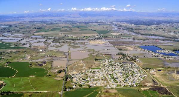 A view of flooding in Weld County, Colo., one of the nation's richest agricultural producers. A secession drive is underway in Weld and 10 other rural counties where residents say they are slighted and ignored by urbanites in and around Denver who control state government.