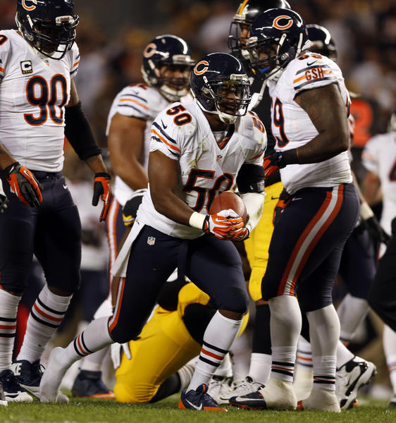 Bears linebacker James Anderson celebrates after recovering a fumble against Pittsburgh.