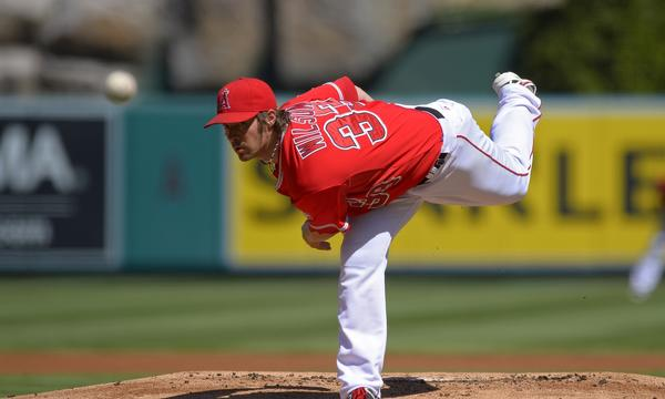 Angels starter C.J. Wilson delivers a pitch during the team's 3-2 loss to the Seattle Mariners on Sunday.