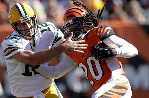 Packers quarterback Aaron Rodgers tries to tackle Bengals safety Reggie Nelson after he recovered a fumble by Johnathan Franklin in the fourth quarter Sunday. Nelson would also fumble but teammate Terence Newman picked up the ball and scored a touchdown.