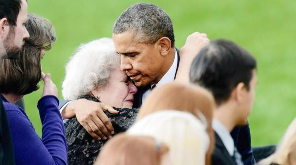 President Obama comforts a woman at a memorial for the victims of the Washington Navy Yard shooting.