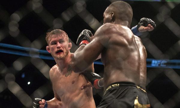 Alexander Gustafsson, left, throws a punch at Jon Jones during their light-heavyweight fight at UFC 165 on Saturday.