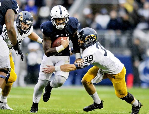 Penn State's Bill Belton gets past Kent State's Luke Wollet Saturday at Beaver Stadium.
