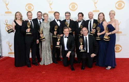 "Show Creator Vince Gilligan (3rd from L), actor Bryan Cranston (C) and producers, winners of the Best Drama Series Award for ""Breaking Bad"" pose in the press room during the 65th Annual Primetime Emmy Awards."