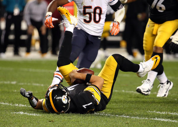 Steelers quarterback Ben Roethlisberger goes down after a sack by linebacker D.J. Williams.
