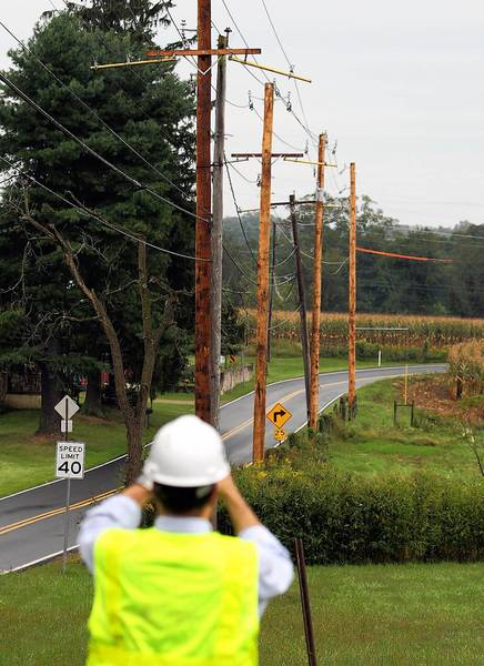"""PPL crews work to erect stronger, taller poles in Lower Milford as part of a """"storm hardening"""" pilot program in southern Lehigh County."""