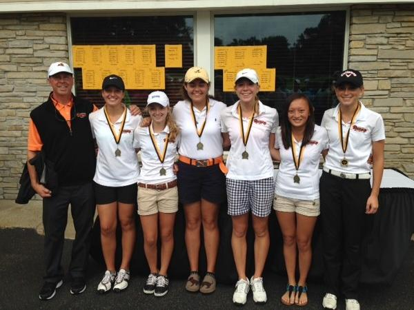 The Harbor Springs High School girls golf team won the Traverse City Central Invitational Friday at the Traverse City Country Club. Team members are (from left) coach Pete Kelbel, Sadie Cwikiel, Zoey Bezilla, Ellen Breighner, Perry Bower, Leah Collie and Abby Detmar.