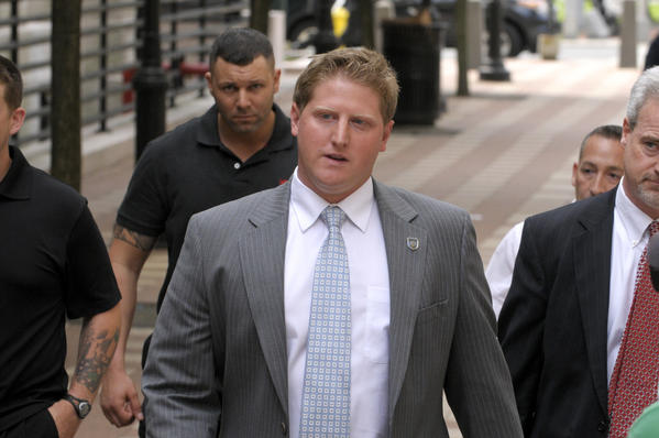 Meriden police officer Evan Cossette leaves the federal courthouse in New Haven in June after he was found guilty of using unreasonable force on a prisoner and obstructing justice.